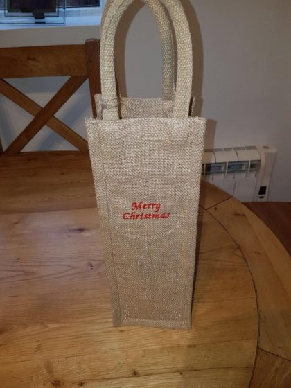 Christmas time, mistletoe and wine (bags)